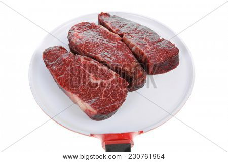 three fresh raw marble beef meat sirloin porterhouse steak on big ceramic cooking pan isolated on white background