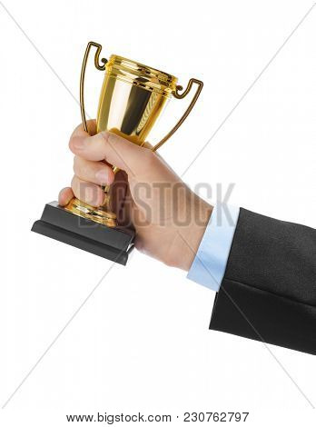 Golden trophy cup in hand isolated on white background