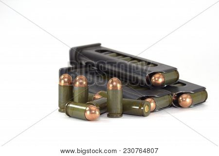 Three Clips With Cartridges For The Makarov Pistol On A White Background Close-up