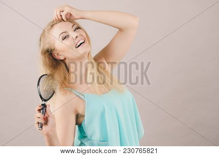 Hapyy Joyful Blonde Woman Brushing Her Beautiful Long Light Blond Hair Seing Results Of Haircare Bea