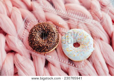 Sweet And Tasty Chocolate Icing Doughnuts With Peanut Sprinkles On Woolen Bed Cover. Fast Food Tradi