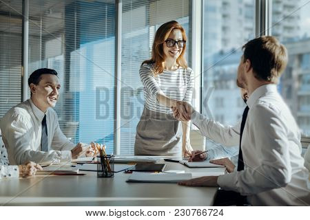 Best Cooperation. Charming Young Woman Carrying Out A Meeting With Her Companys Business Partners An
