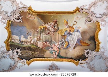 AMORBACH, GERMANY - JULY 08: Saint Martin and Saint Wendelin, fresco by Matthaus Gunther in Benedictine monastery church in Amorbach, Germany on July 08, 2017.