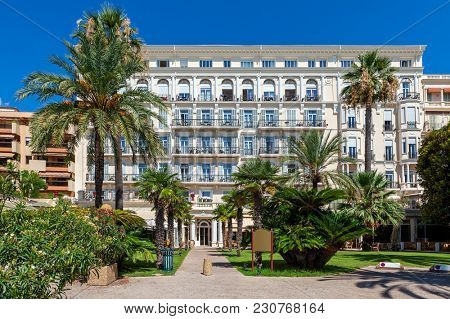 Front view of luxury hotel in small town of Menton on French Riviera.