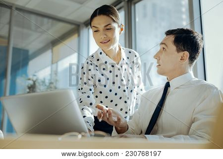 Unexpectedly Skilled. Pleasant Young Man Looking At His Female Colleague With A Surprised Expression
