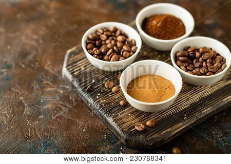 Set Of Coffee Beans, Ground Coffee And Instant Coffee In White Bowls