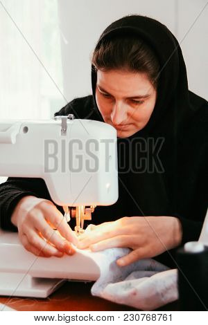 Starosillia, Volyn / Ukraine - February 04 2009: Nun With Sewing Machine At Monastery