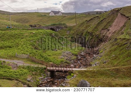 Melvaig, Scotland - June 9, 2012: Flimsy And Old Bridges On Rural One-lane Road Over Crevasse In Gre