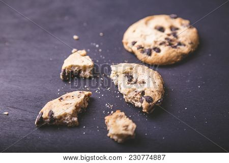 Сookies  With Chocolate Pieces  On Dark Background. Tasty Cookies And Crumbs On Dark Background