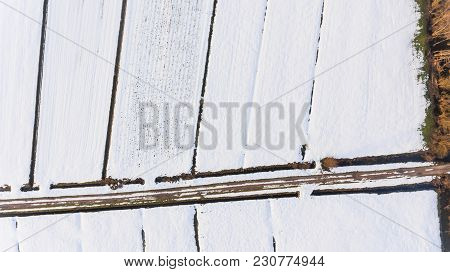 Drop Down View Of Snow Covered Fields. Winter Aerial Photography.