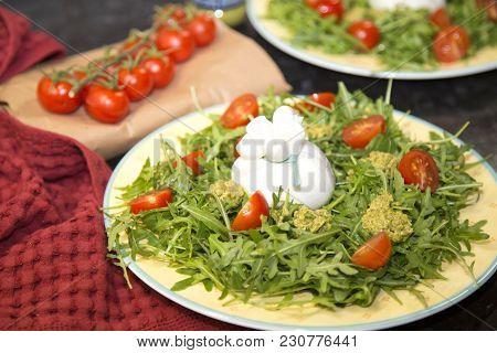 Italian Burrata With Cherry Tomatoes And Pesto Sauce