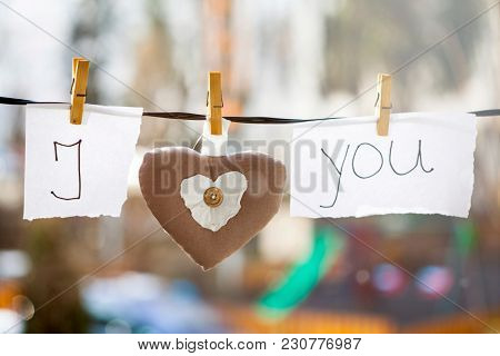 I Love You background. Heart and note with words
