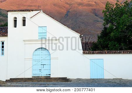 Beautiful White Villa With Shingle Roofs Hidden Behind Walls In Colonial Villa De Leyva. San Agustin