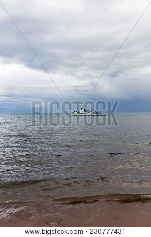 Ship At Sea In Bad Weather . In The Park In Nature