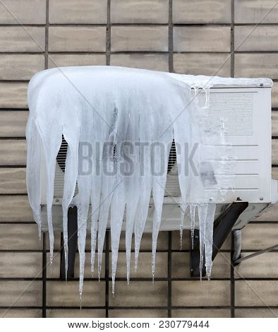 The External Unit Of The Air Conditioner Is Covered With Large Icicles. Incorrect Use Of The Air Con
