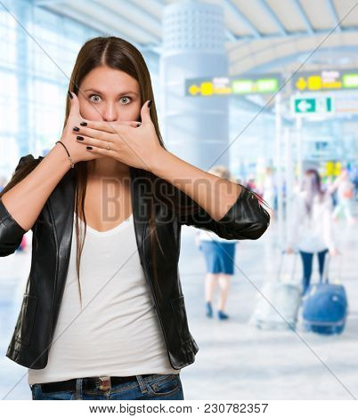Shocked woman covering her mouth, indoor