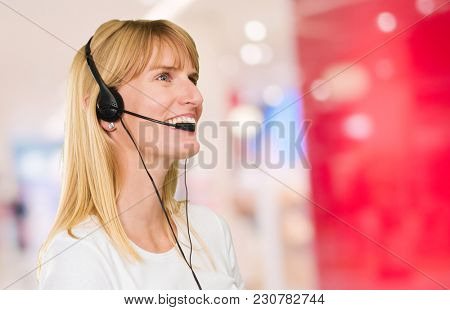 Happy Woman On Headset against an abstract background