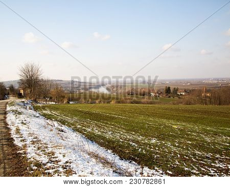 Snowy Landscape With River On The Background