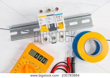 Electrical Modular Circuit Breaker, Insulating Tape And Digital Multimeter. Electrical Network Prote