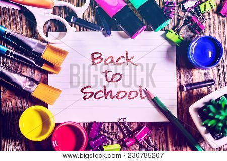 Ack To School Background With School Supplies On Wooden Background.