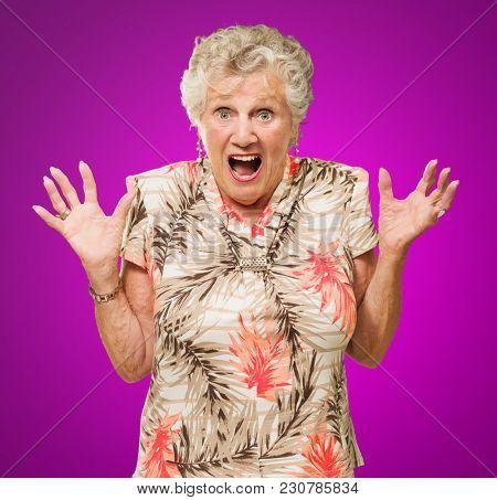 Portrait Of Shocked Senior Woman On Purple Background