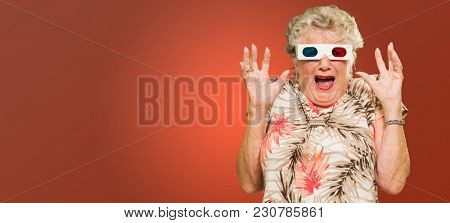 Afraid Senior Woman Watching 3d Movie Screaming On Red Background