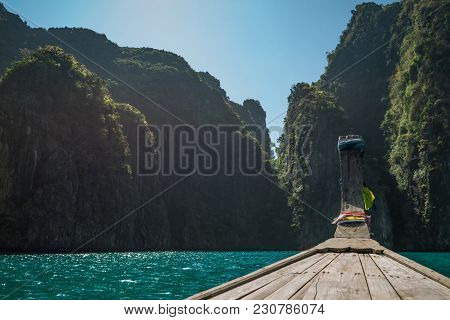 Travel Destinations In Asia. Long Tail Boat Moored Near The Rocks And Hills At Phi-phi Island Lagoon