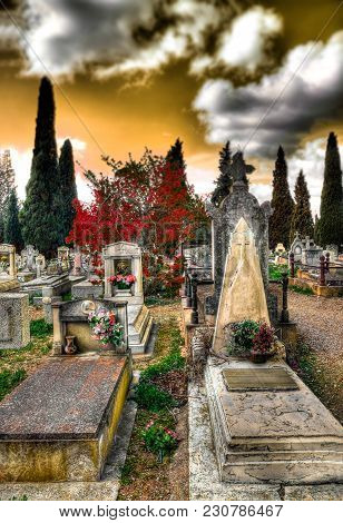Scenic cemetery  and tombstone.Gravestone and Halloween background.Surreal graveyard. poster