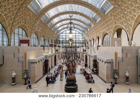 Paris, France, March 28 2017: Visitors in the Musee d'Orsay in Paris, France. The museum houses the largest collection of impressionist and post-impressionist masterpieces