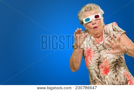 Afraid Senior Woman Watching 3d Movie On Blue Background