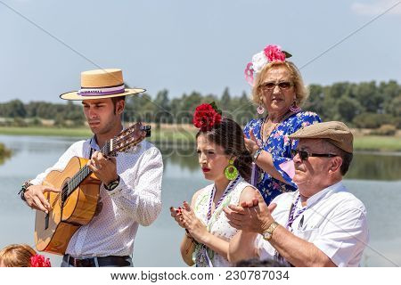 El Rocio, Spain-may 22, 2015 Spaniards Celebrate A Religious Festival, Singing And Dancing During Th