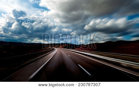 Road Scenery. Travel Concept.cloudy Sky And High Road.