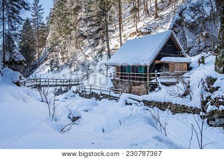Old Wooden Hut In Snow Covered Frozen Icy Gorge Baerenschuetzklamm In Winter
