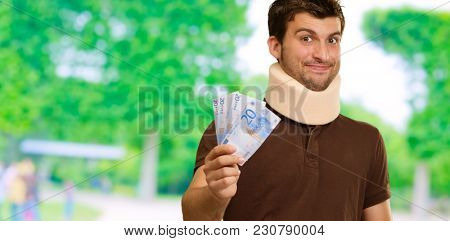 Disabled Man With Neck Brace Holding Euro Note, Outdoors
