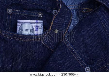 Hundred Dollar Bills Sticking Out Of The Pocket Of Denim Jeans.closeup