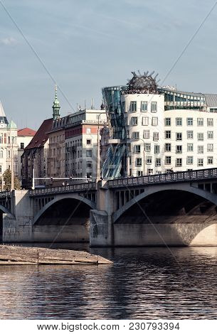 Prague, Czech Republic - September 25,2016: Dancing House. The Embankment And The Bridge. The Archit