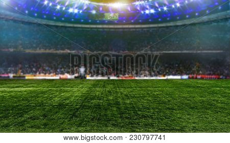 Stadium night, lit. with green grass