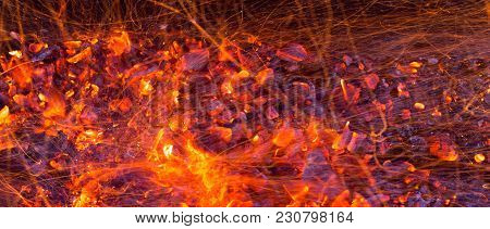 Burning Charcoal As Background . Photo Of An Abstract Texture