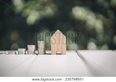Saving To Buy A House Or Home Savings Concept With Money Coin Stack Growing.saving Money Concept.