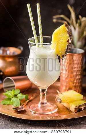 Homemade Frozen Pina Colada Cocktail With Rum, Coconut Milk And Pineapple Garnish Over Black Backgro