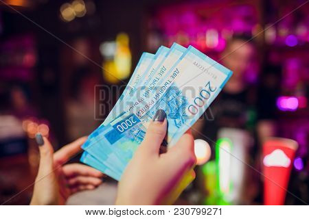 Girl Holds 5 New 2000 Rubles Cash And Pays For A Cocktail In The Club Restaurant