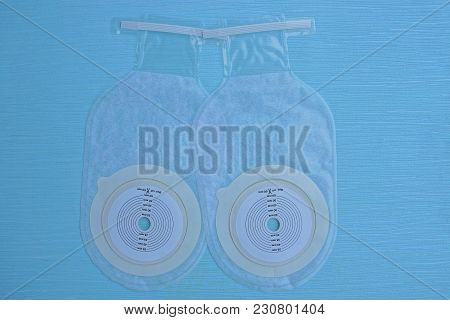 Two Plastic Colostomy, On A Blue Table