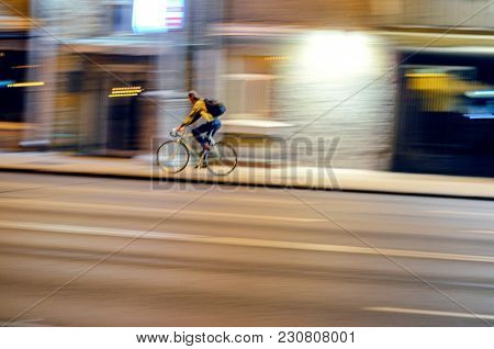 Motion Blur. Abstract Blur Picture Of Male Cycling On Fixed Gear Bicycle In Night Cityscape, Speed C