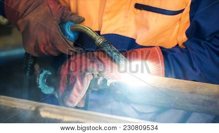 Welding With Wire Welding : Industrial Welder, Steel Beam, Light And Sparks. Metal Welding Worker We