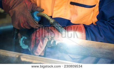 Welding With Wire Welding : Industrial Welder, Steel Beam, Light And Sparks. Metal Welding Worker We
