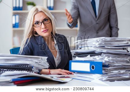 Angry irate boss yelling and shouting at his secretary employee