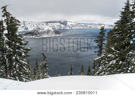 Clouds Roll By The North Rim At Crater Lake Towards Mt Scott In The Winter