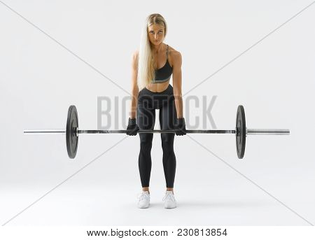 Front View Of Confident Young Blonde Woman Doing Weight Lifting Workout Attractive Young Woman Bodyb