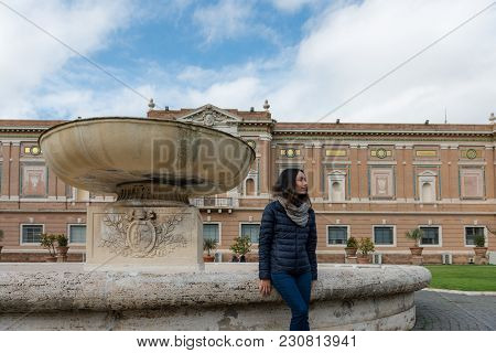 Horizontal picture of woman posing at the Vatican Museum in Rome, Italy