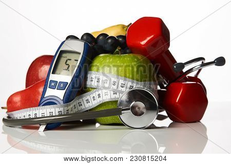 Stethoscope With Blood Sugar Control Glucometer Glucose Meter, Fruits And Dumbbells For Using In Fit